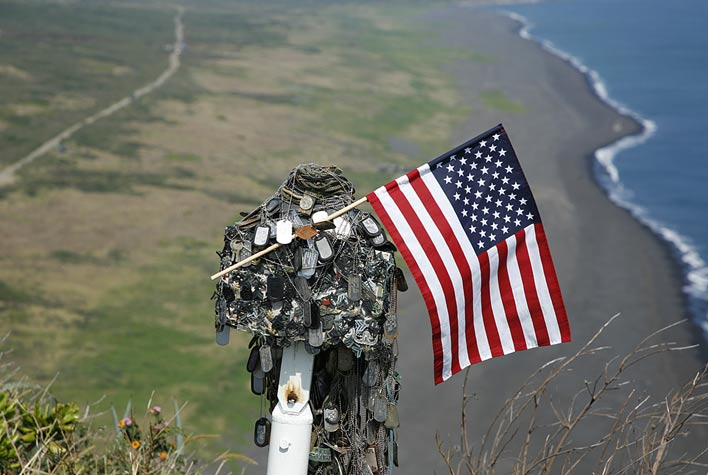 Makeshift memorial on top of Mt Suribachi above landing beaches