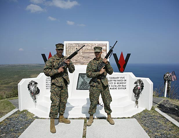Modern day US Marines at USMC monument on Mt Suribachi