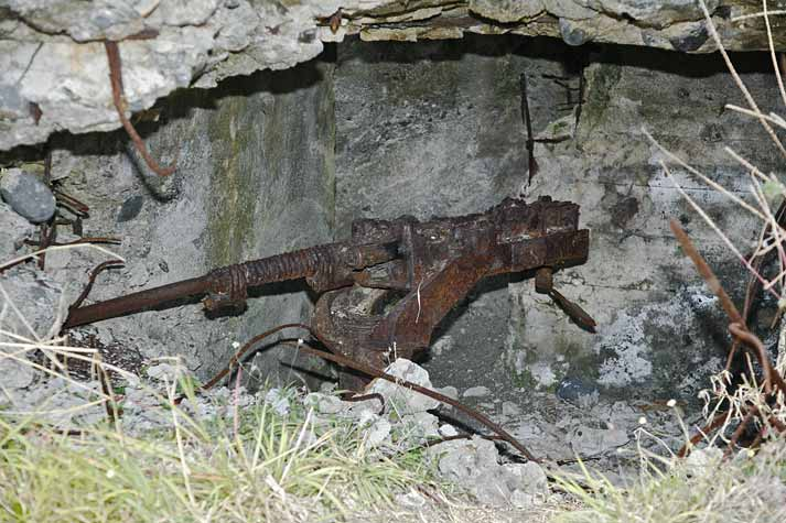 Japanese machine gun in destroyed bunker near beaches